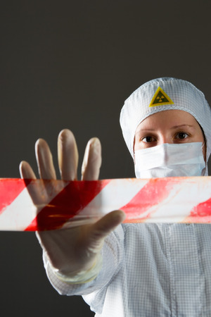 scientist in white protective suit, prohibits entry to the territory, dangerous
