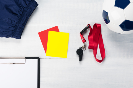 set of things for the referee for a football match against a light background