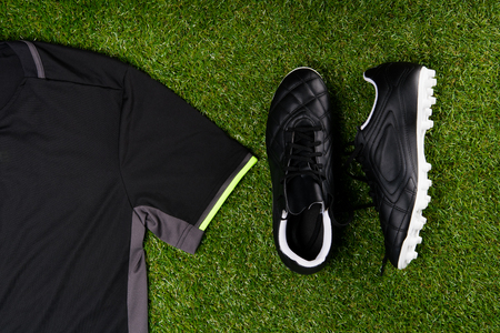 football boots and a sports shirt against the background of grass