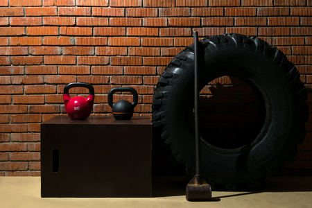 Equipment for endurance sports and fitness training on the background of a red brick wall