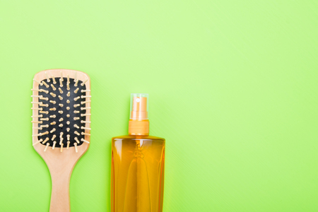 set of tools and items for combing hair, on a green background