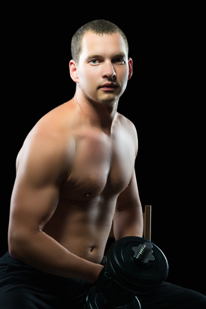 man is doing sports to improve the body on a black background Stock Photo