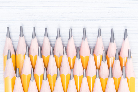a lot of simple pencils lie on the table, close-up Stock Photo