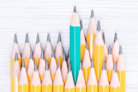 background of yellow simple pencils neatly lie in a row, close-up Stock Photo