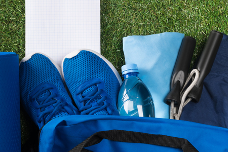 men's set of blue sports things in a bag, on a green lawn, there is a place for recording, on a white sheet Stockfoto - 107993184