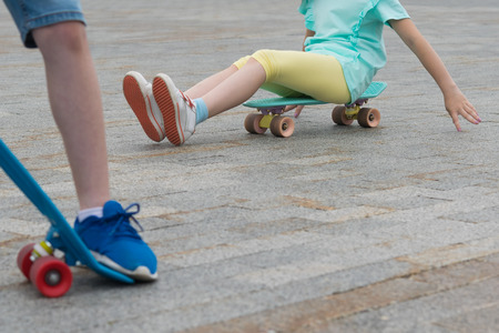 two children's sports boards, with different elements, on stone paving stones Zdjęcie Seryjne