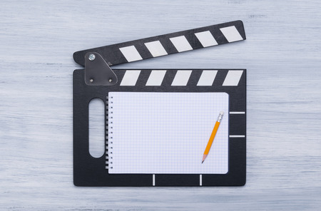 movie movie for filming, with space for inscriptions and a pencil on a white sheet