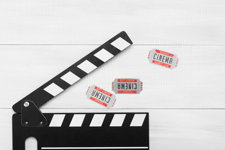 movie tickets and clapperboard for filming a movie on a light background Stock Photo