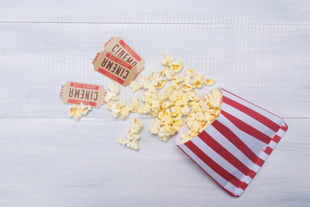 cinema popcorn packaging and two movie tickets Stock Photo