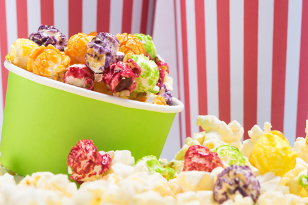 paper cup with multicolored sweet popcorn, beautiful background for an inscription Stok Fotoğraf