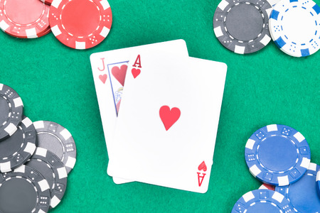 concept of cards and poker chips on a green table