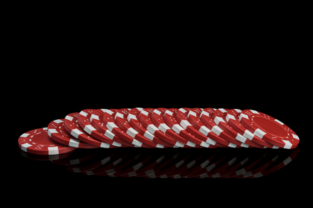 red poker chips lie in a row and are reflected in a black background