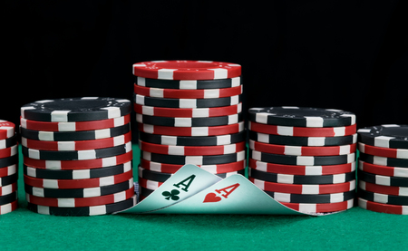 big bet on the green table and two poker playing cards Stok Fotoğraf - 119361138