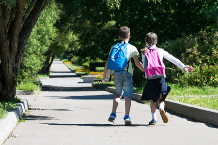 children ran away from school with the lessons in good weather Stock Photo