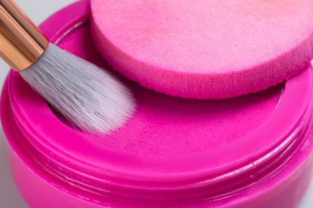 bright pink eye shadow for applying makeup on the eyelids with a brush, closeup Stock Photo