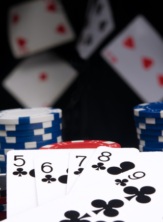 on black background and flying cards, poker chips and winning hand, street 写真素材 - 124261865