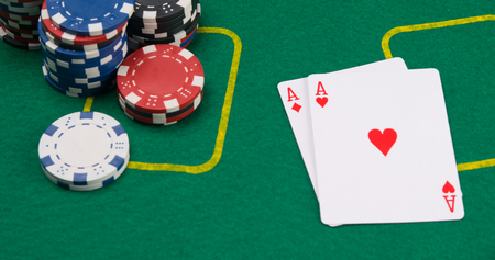 on the green table, two highest cards and multi-colored chips to play twenty-one Stock Photo