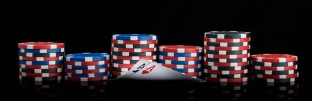long background of poker gaming chips and two winning cards