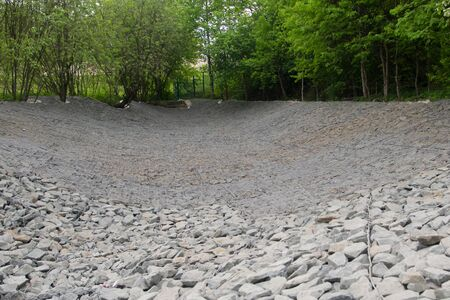 dried river bed, for strengthening and building soil in grids with rubble