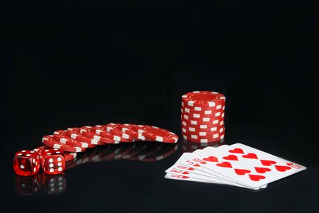 on a black background, with reflection, red chips and dice, near the alignment in poker, street 写真素材 - 126060412