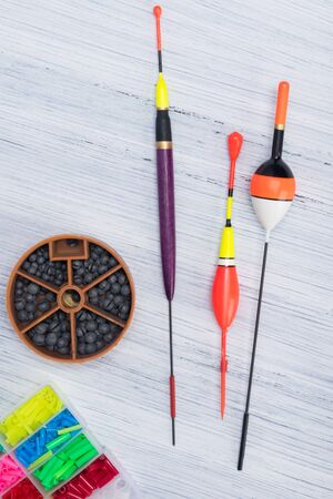 set of items for fishing with a fishing rod on a light background