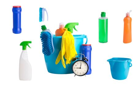 collage of multi-colored bottles of cleaning products on a white background and a black alarm clock Stock Photo