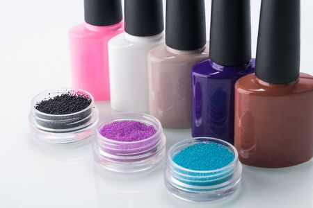multi-colored nail polish and decoration for their design, close-up on a light background Stock Photo