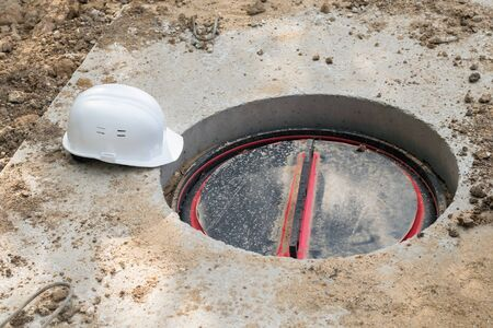 builder hatch and work helmet on the ground, top view Stock Photo
