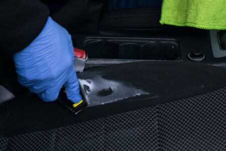 dry cleaning of a car seat with chemicals, closeup view Stock Photo