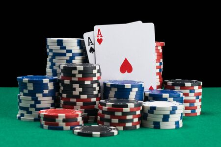 winning cards and winning chips background a green poker table