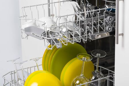dry clean dishes in the basket of an open dishwasher Stok Fotoğraf