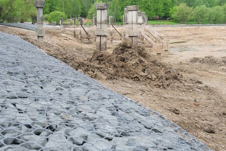 a pile of gray stone lie on the ground at a construction site