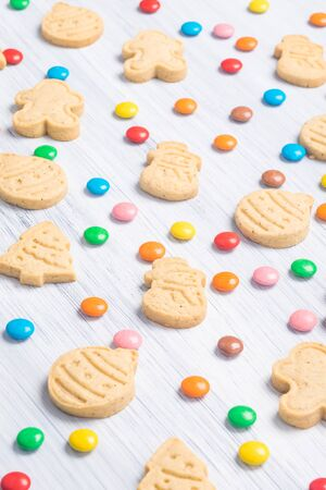 Christmas different shaped cookies and multi-colored sweets on a light gray background Stockfoto