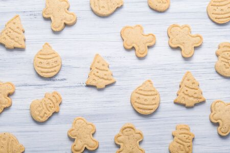 on a light gray background, cookies in the form of a Christmas tree, a snowman and Santa Claus Stockfoto - 134207064