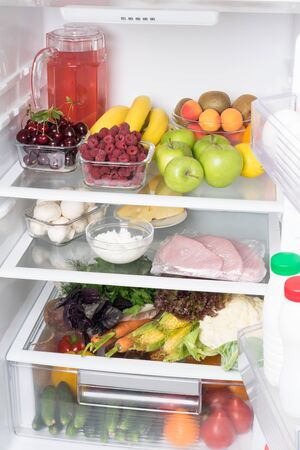 open fridge with vegetables and fruits, front view Stockfoto - 134207719