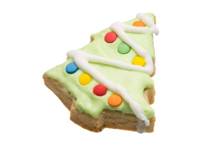 gingerbread cookie in the form of a decorated green Christmas tree isolated on a white background