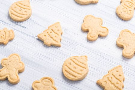 gingerbread cookies of different shapes on a gray background