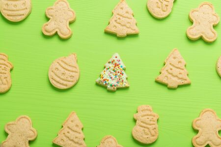 gingerbread cookies of different shapes on a green background
