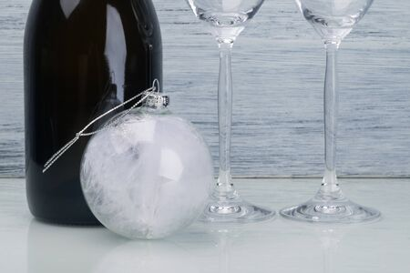 new year and christmas concept from champagne bottle, glasses and christmas ball Stockfoto