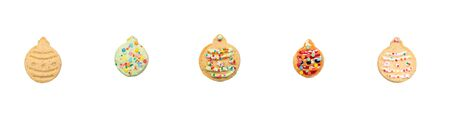 on a white background, sweet gingerbread with caramel and colorful sprinkles, laid out in a row