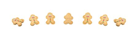 on a white background, sweet cookies in the shape of a snowman, with icing and colorful dragees, are laid out in a row Stockfoto