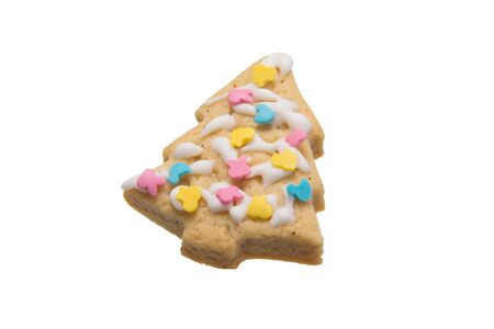 confectionery, cookies in the form of a Christmas tree decorated with colorful dragees, close-up, isolate Stockfoto