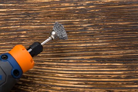 tool for engraving on iron and creative work lies on a wooden burnt background Stockfoto