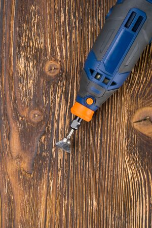 power tool for creativity on metal lies on a wooden background