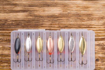 set of lures for fishing, close-up, on a dark wooden background