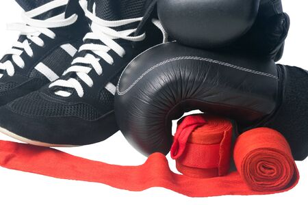 black gloves, red bandages for protection from injuries in Boxing and sneakers, on a white background, close- up Stock Photo