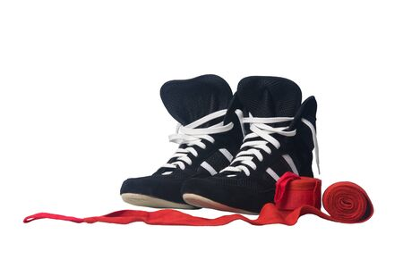 red bandages for protection from injuries in Boxing and sneakers, on a white background, close- up
