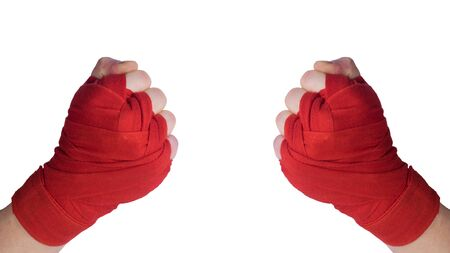 two hands in protective red bandages clenched into a fist, front view, isolated on white background