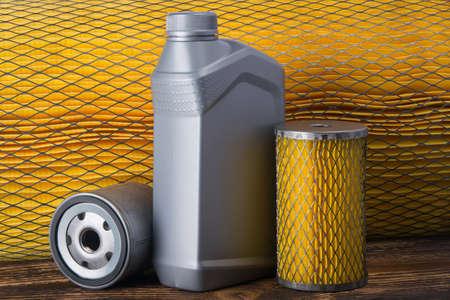 against the background of yellow, air filter, grey car oil bottle Reklamní fotografie