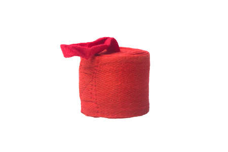 red bandage for wrapping hands in Boxing, on a white background, close- up